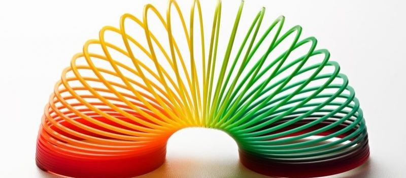 Rainbow coloured slinky toy